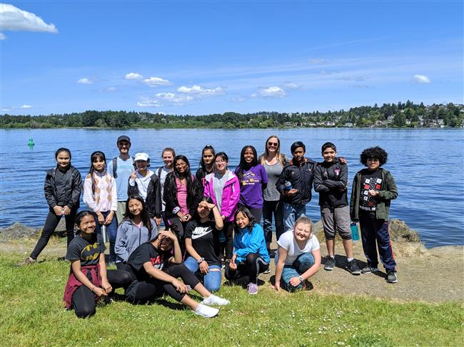 Group photo in front of lake